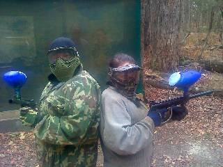 Two 'hardcore' ladies about to begin a paintball duel.