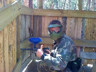 Defending is going so well, this paintball player has time for a photo op.