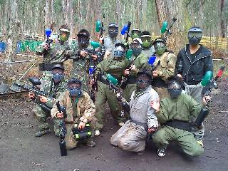 Paintball markers in hand, goggles on.
