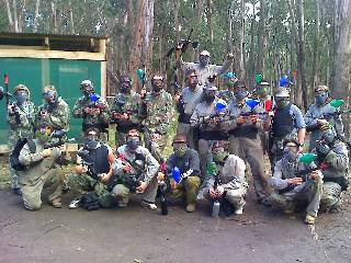 Paintball markers in hand, masks on.
